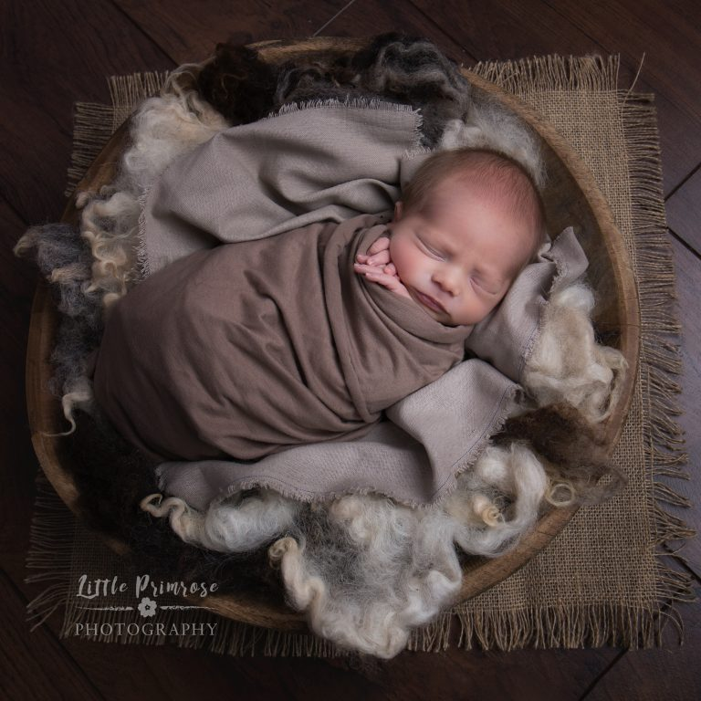 Newborn photography Cheshire baby wrapped in bowl with fluff