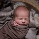 Newborn photography Sandbach - Baby wrapped in bowl with fluff