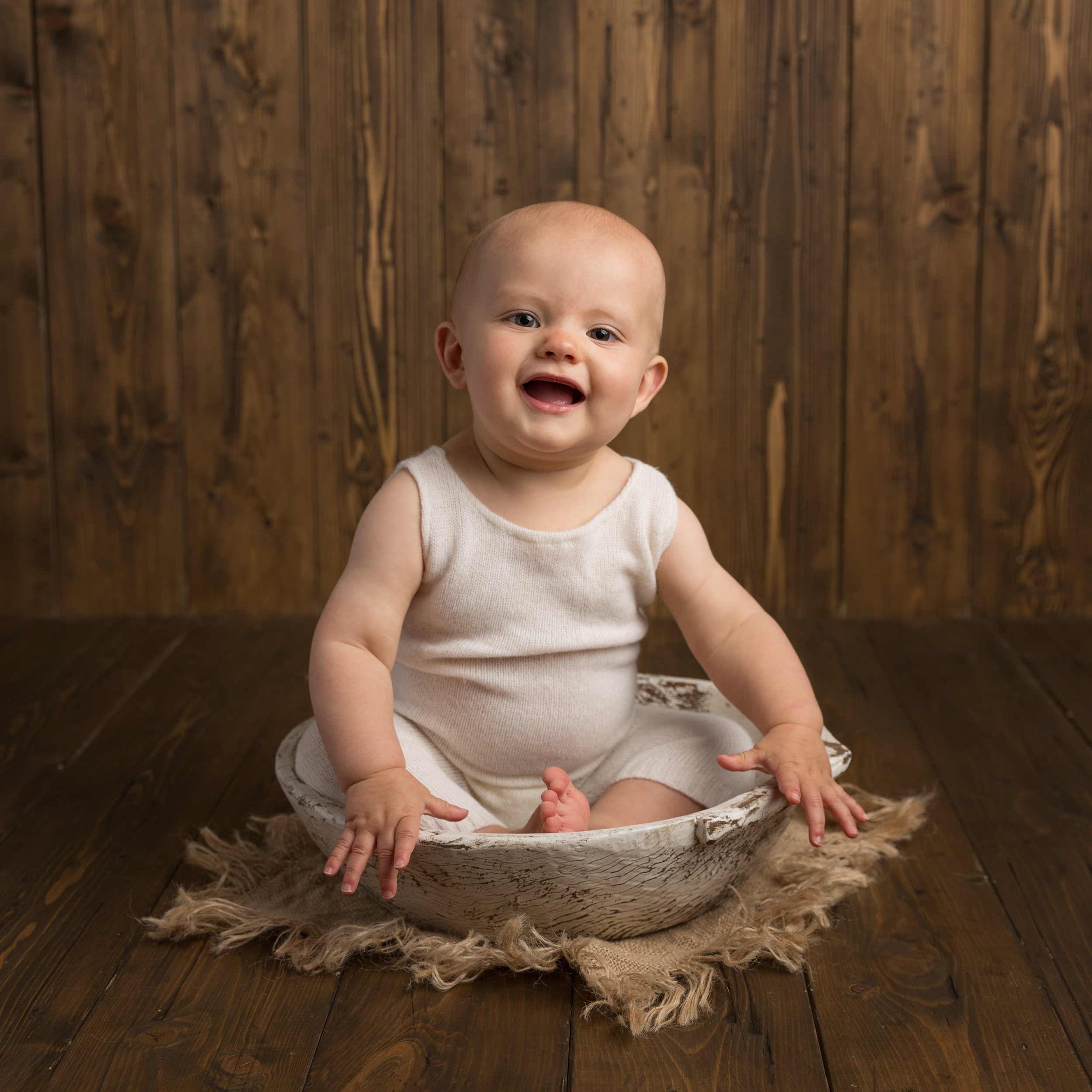1 year old sitting in a white bowl