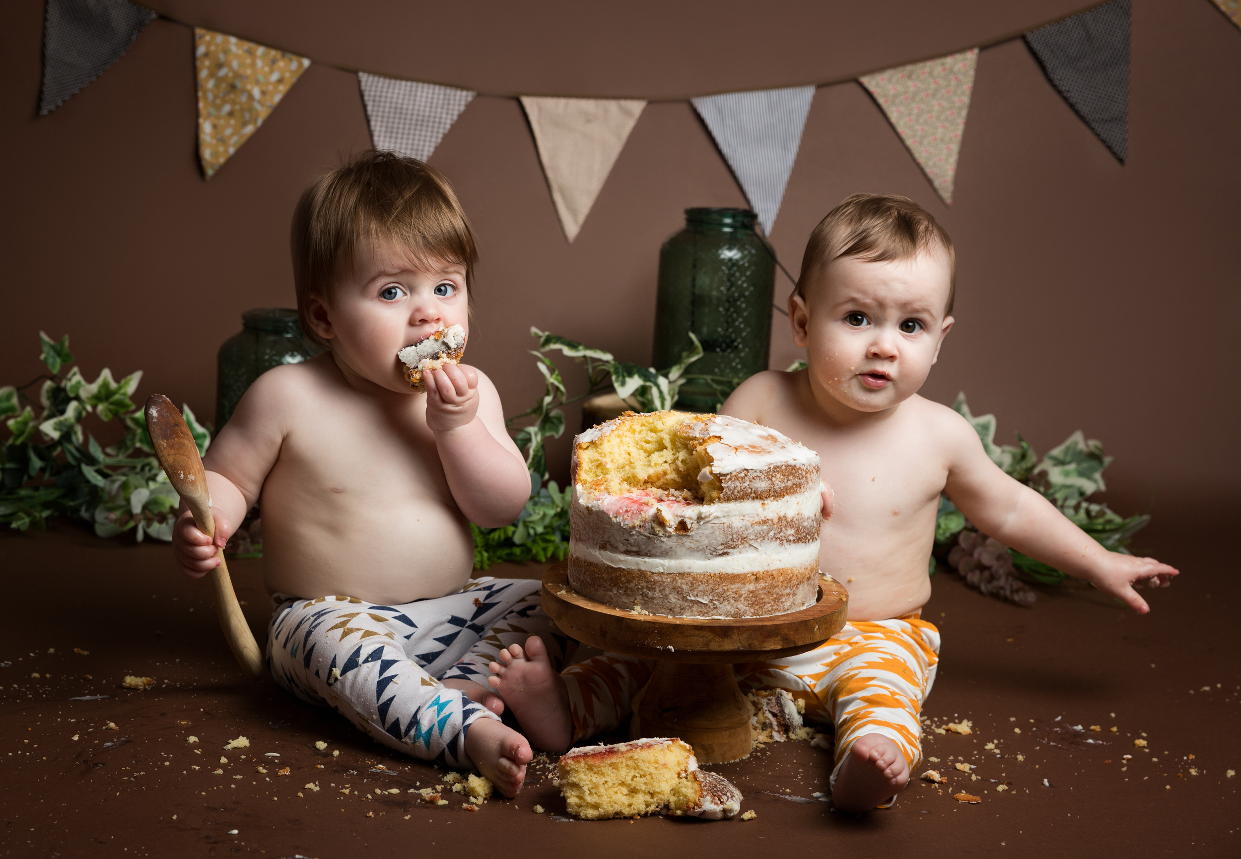 Twin boys eating cake in their photo shoot in Cheshire
