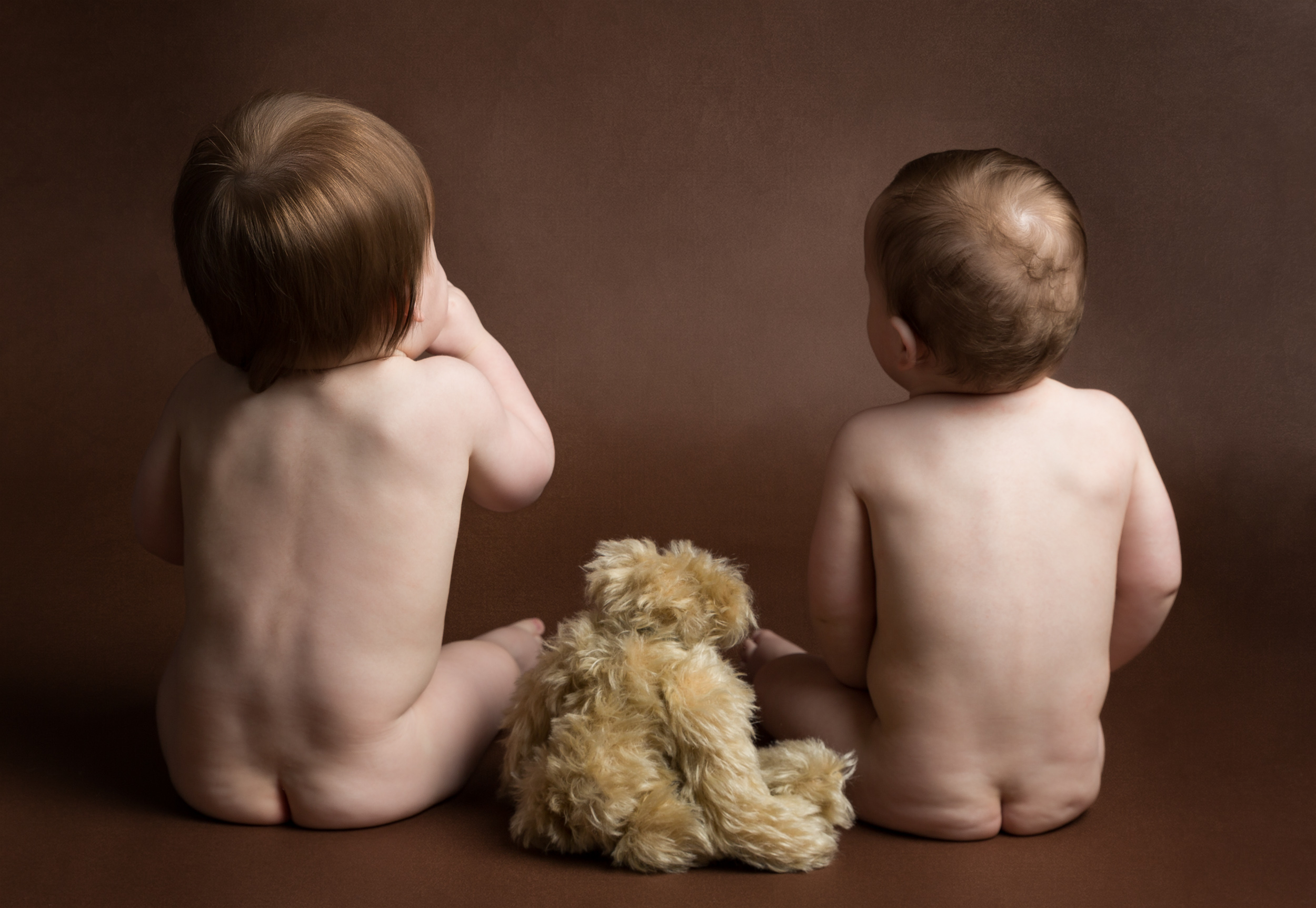 1 year old twins with their teddy during their photo shoot in Cheshire