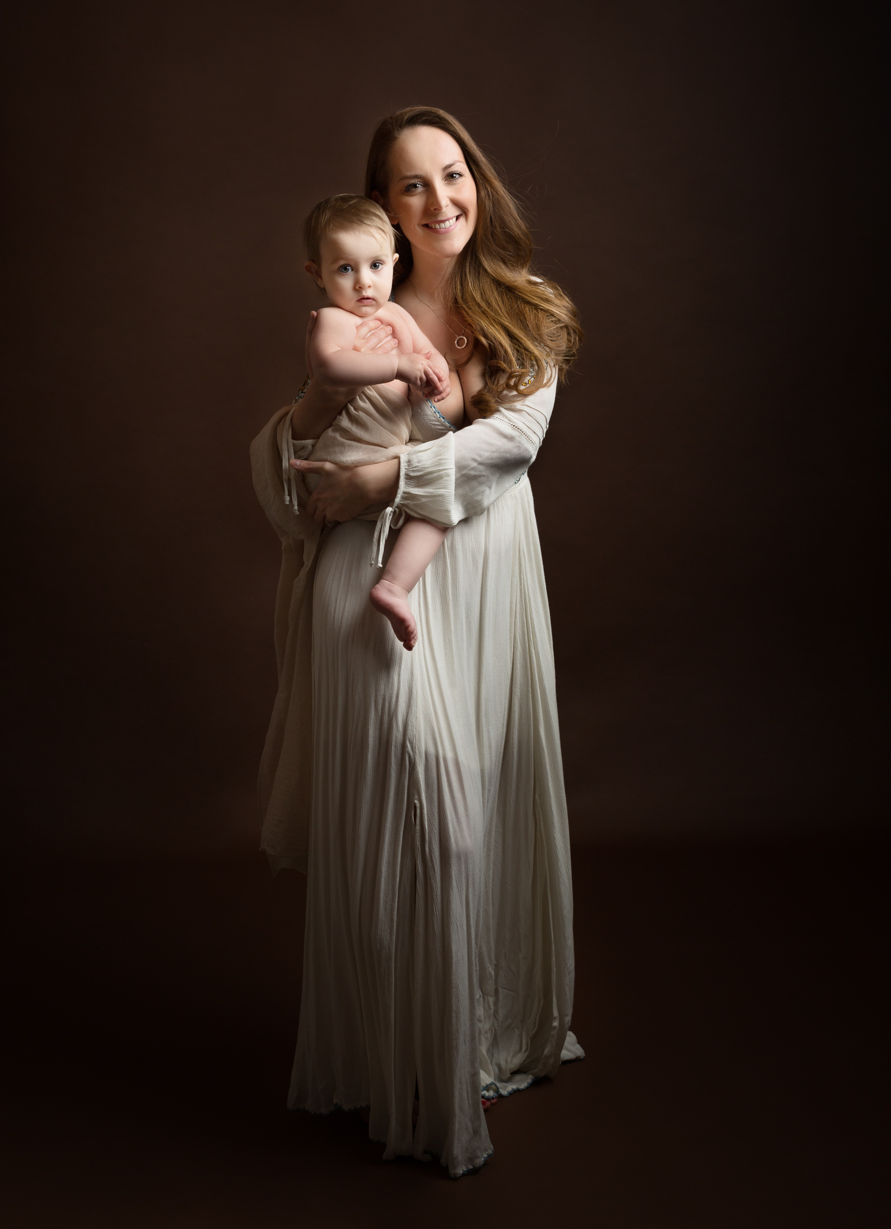 Mummy and baby together in a dramatic portrait in Cheshire