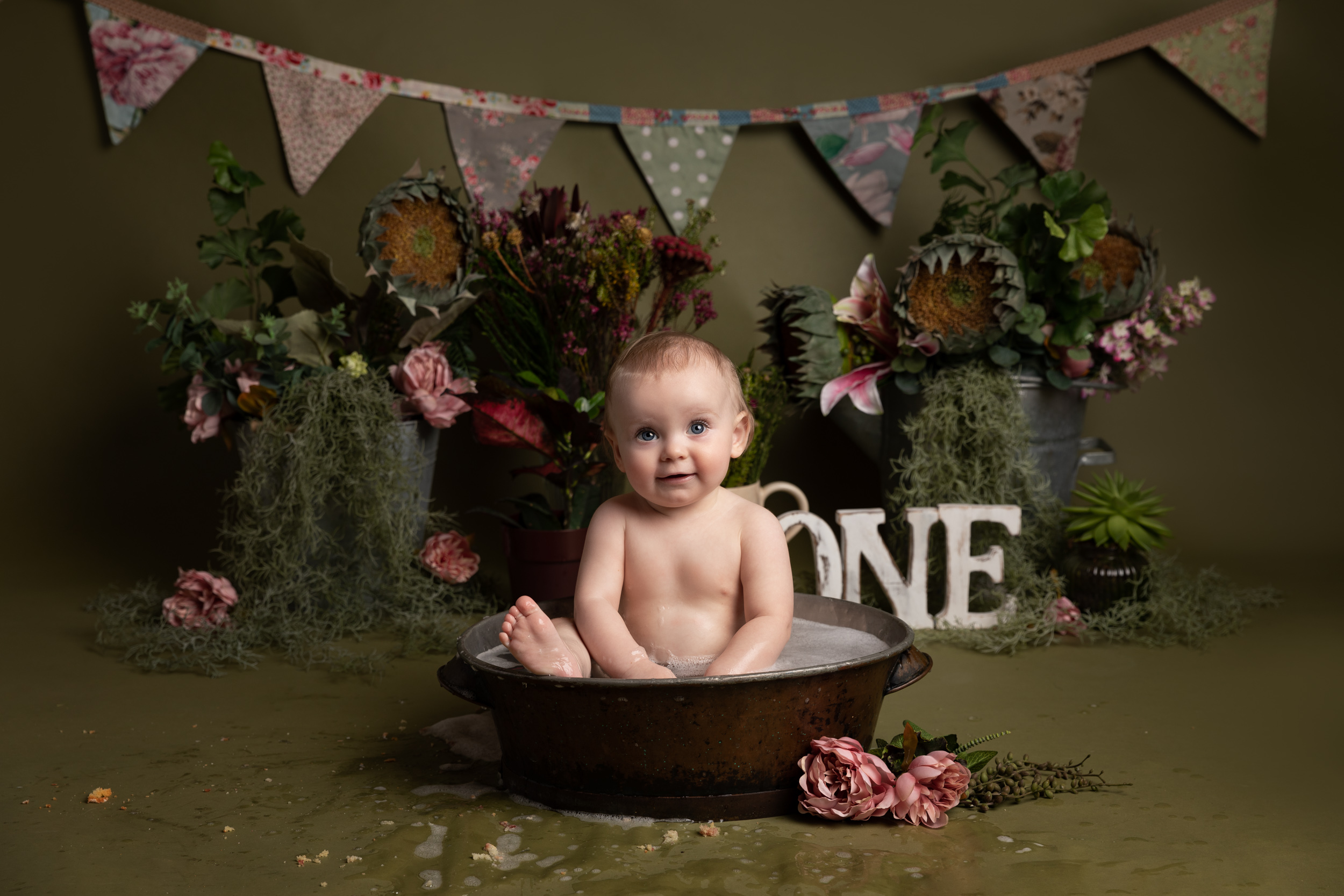 Little girl in the bath after her botanical themed photo shoot in Cheshire