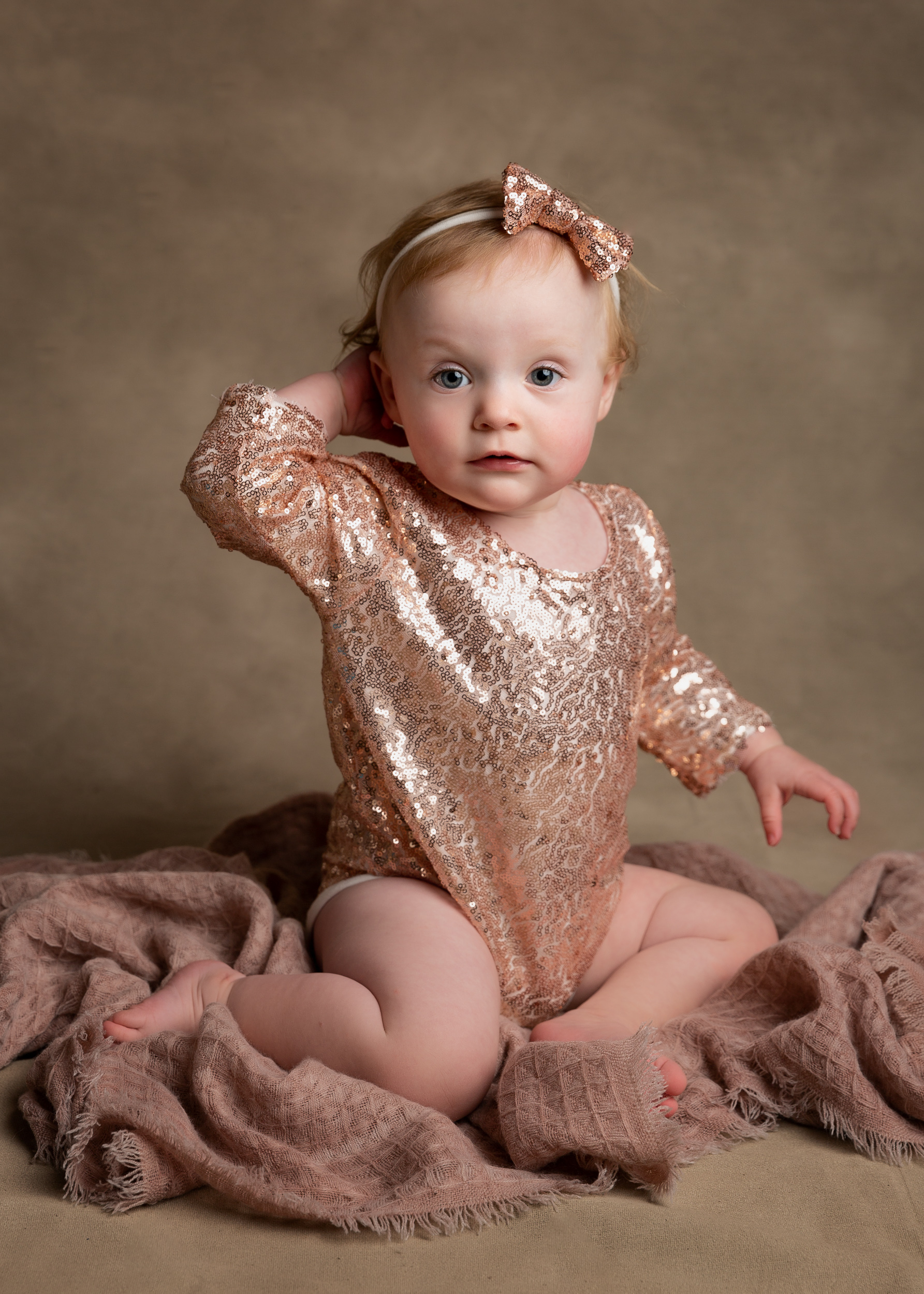 Little girl in a sparkly outfit to celebrate her first birthday with a photo shoot in Cheshire