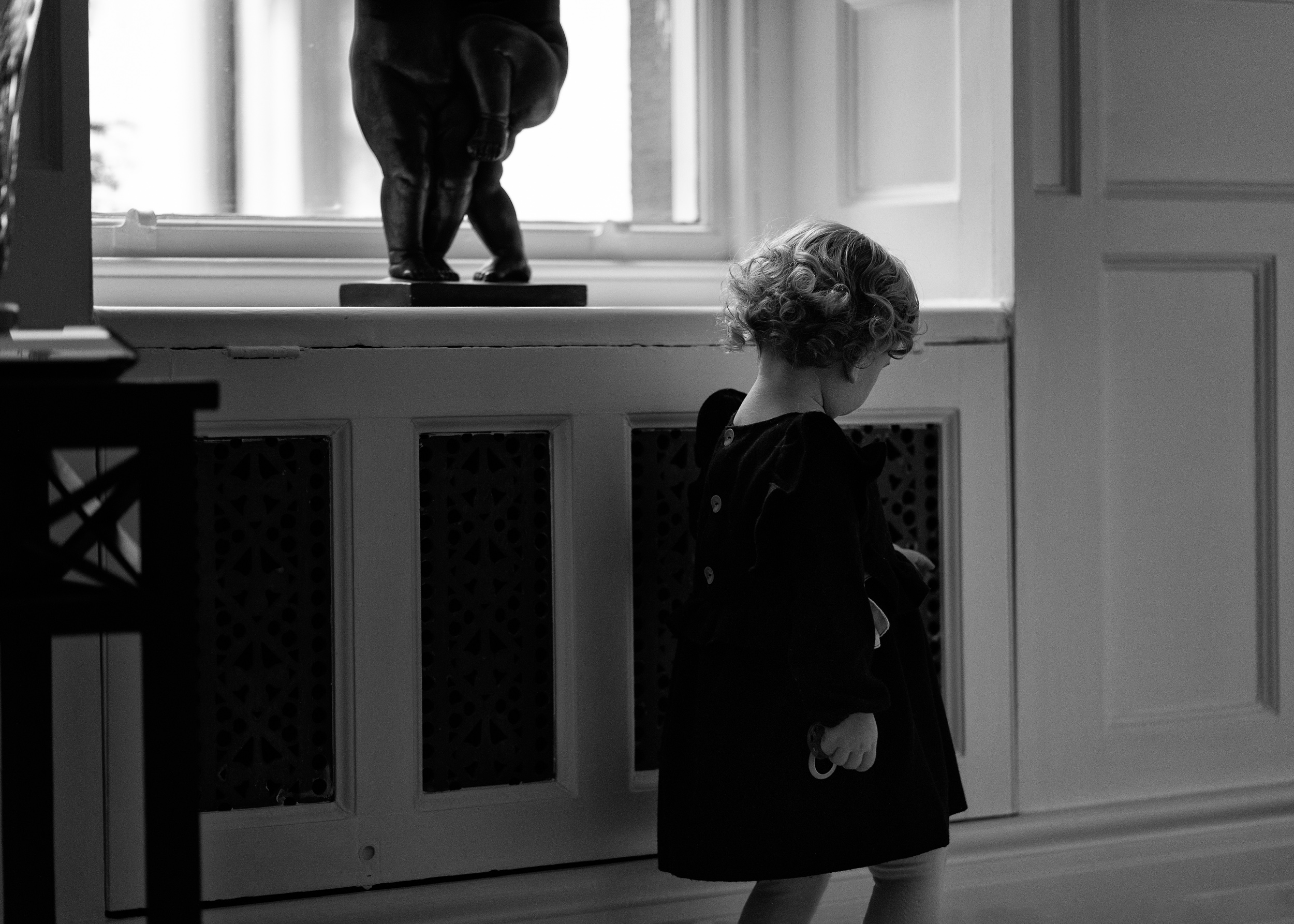 A little girl wandering the halls of her grandparents home in Lancashire