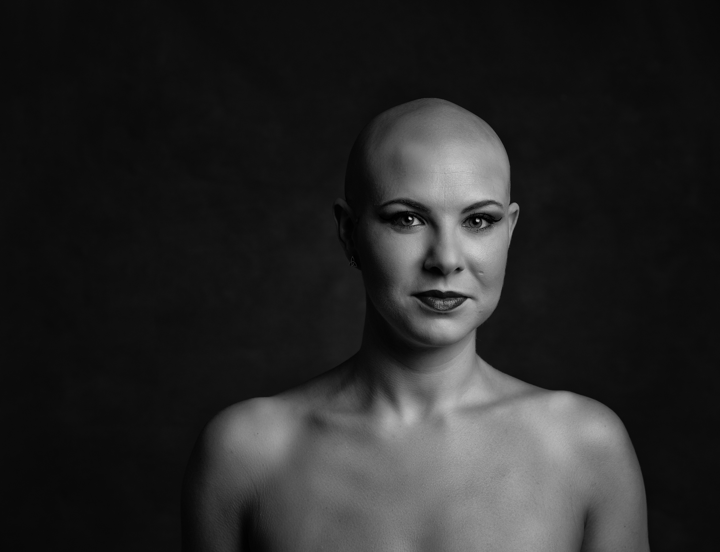 Dramatic portrait of a beautiful lady with no hair for her portrait session in Sandbach, Cheshire