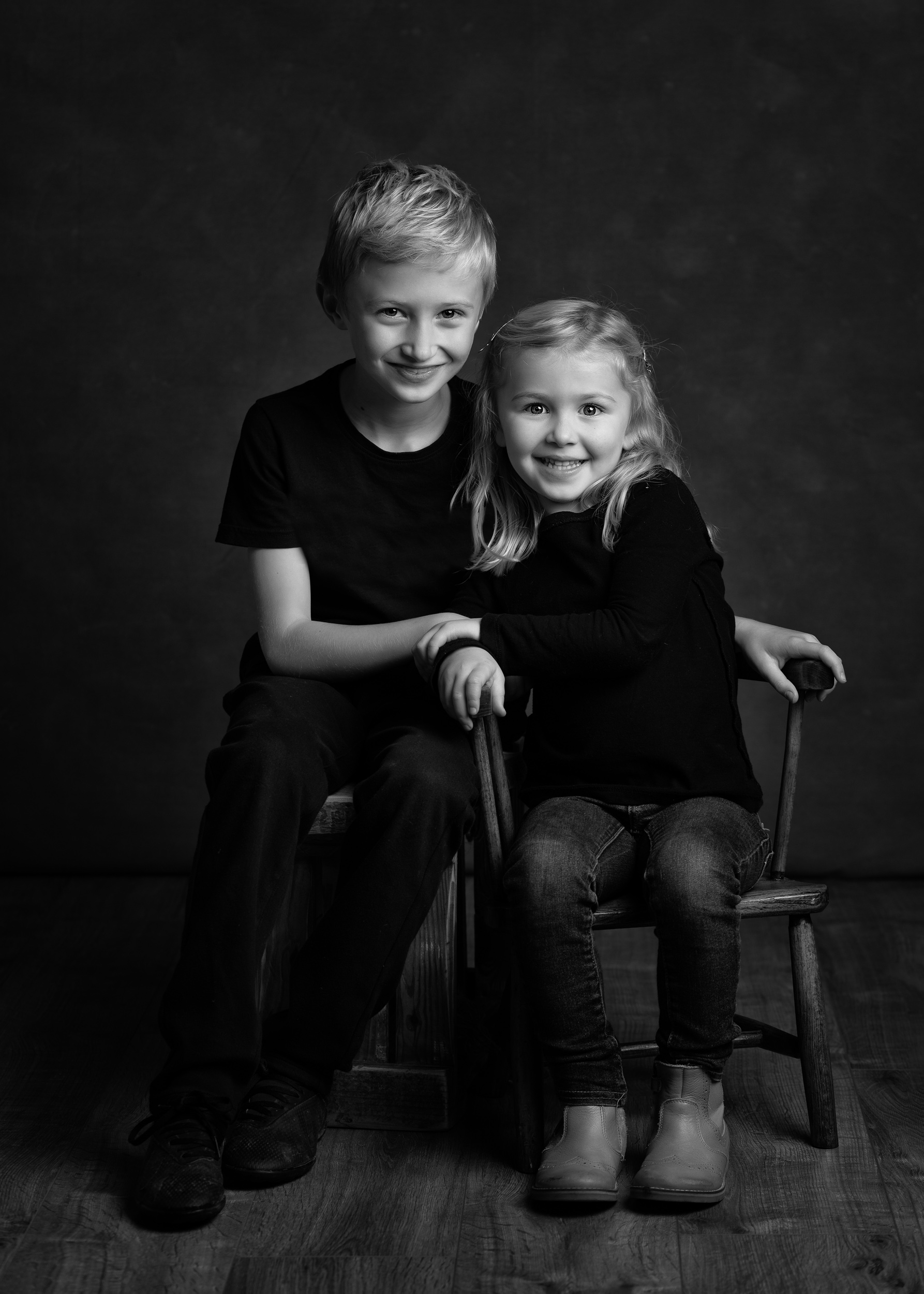 Black and white portrait of a brother and sister posing together at their Family Portrait photo shoot in Cheshire