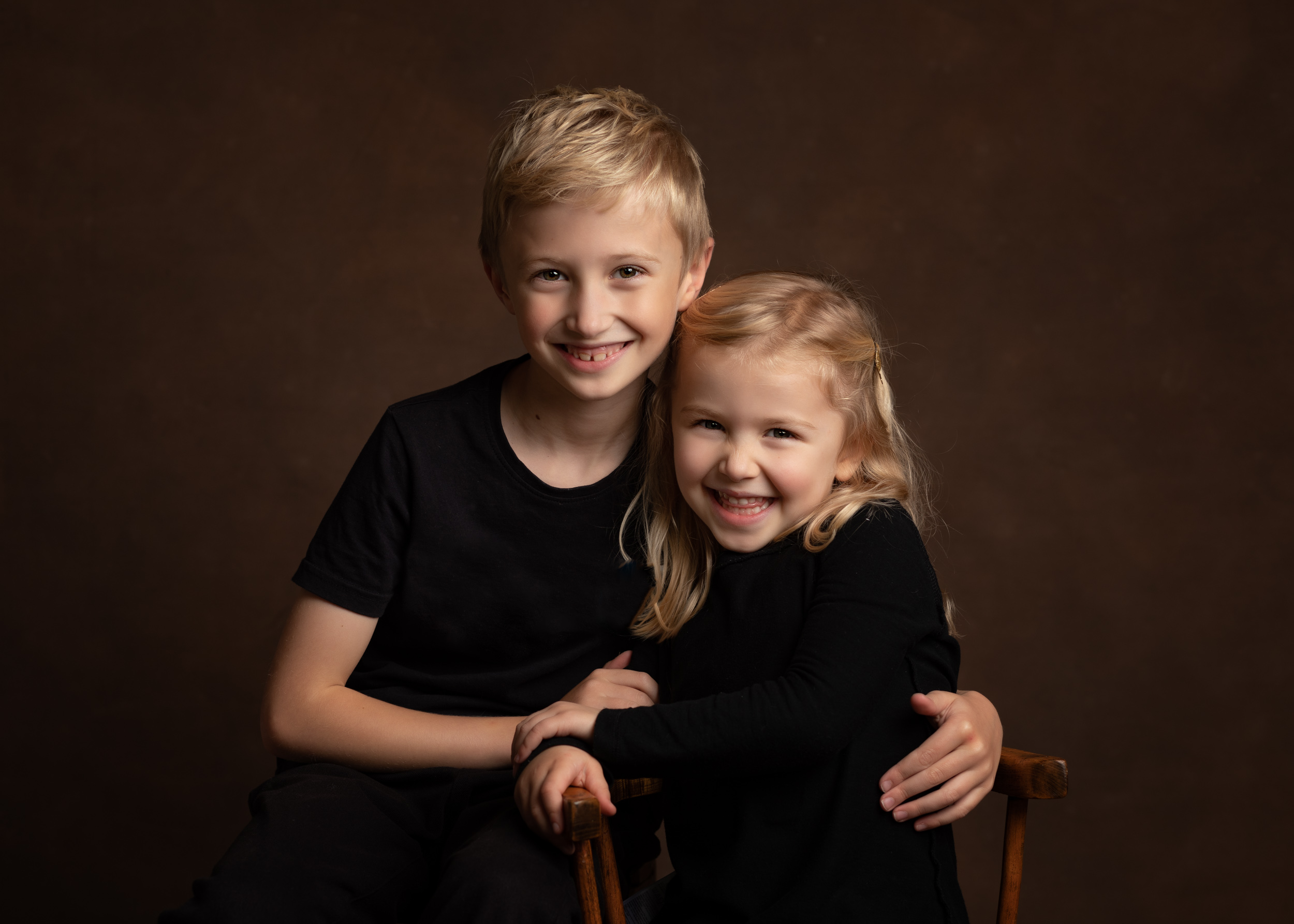 Cute blonde brother and sister posing together for their Family Portrait photo shoot in Cheshire