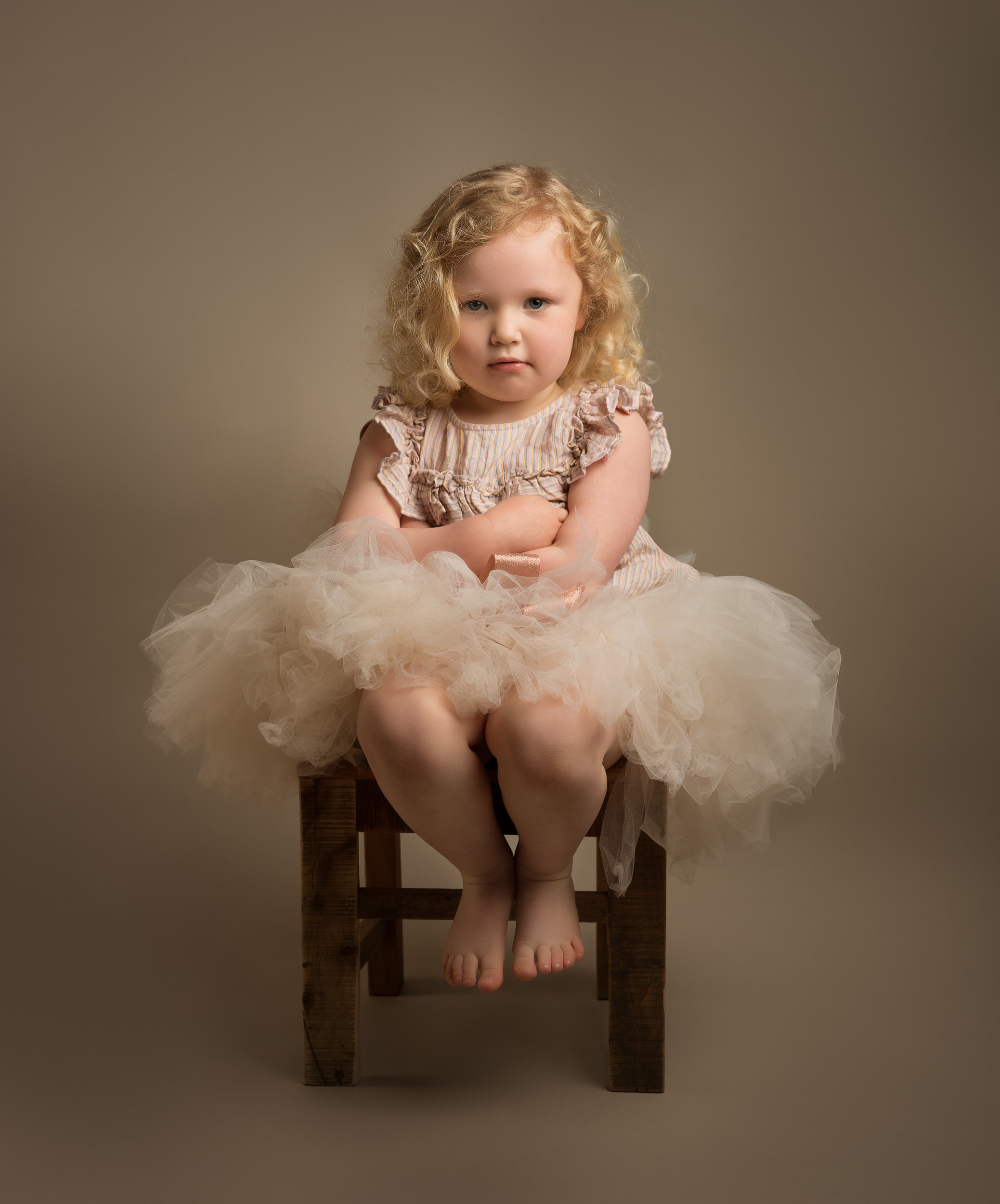 Grumpy little balerina shot of a little girl from her Family Portrait photo shoot in Cheshire