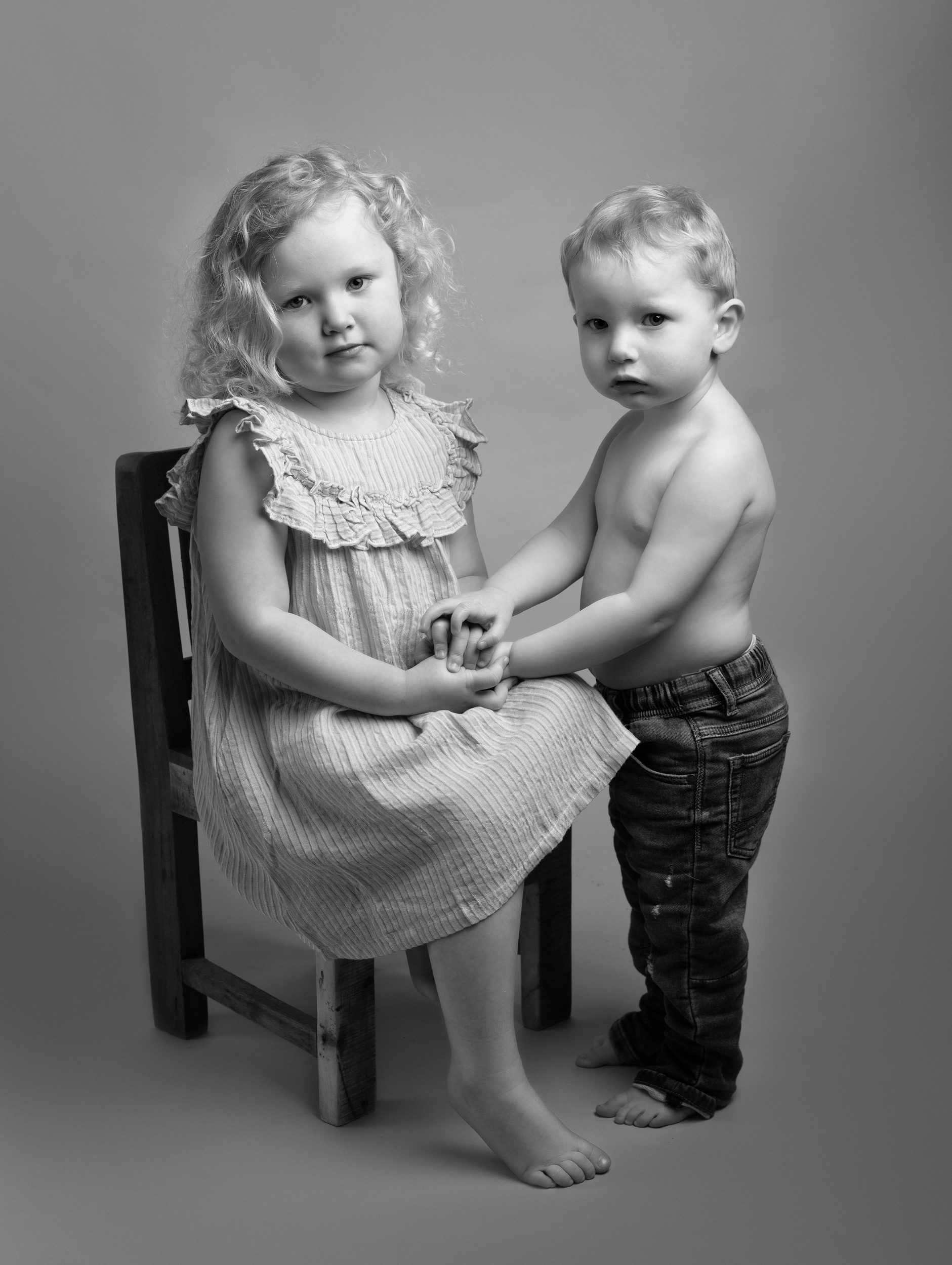 Brother and sister pose together at their Family Portrait photo shoot in Cheshire
