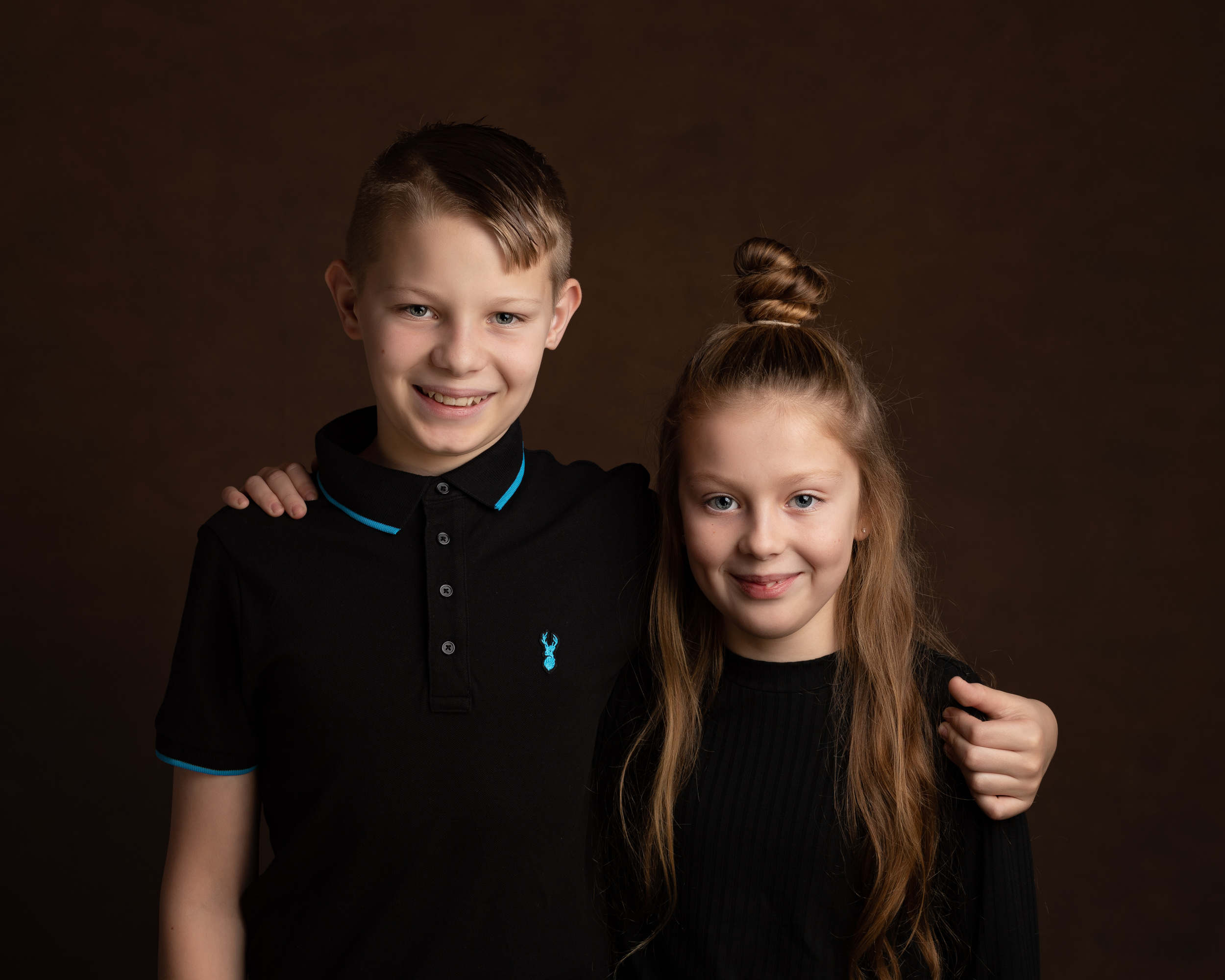 A brother and sister posing together during their Family Portrait photoshoot in Cheshire