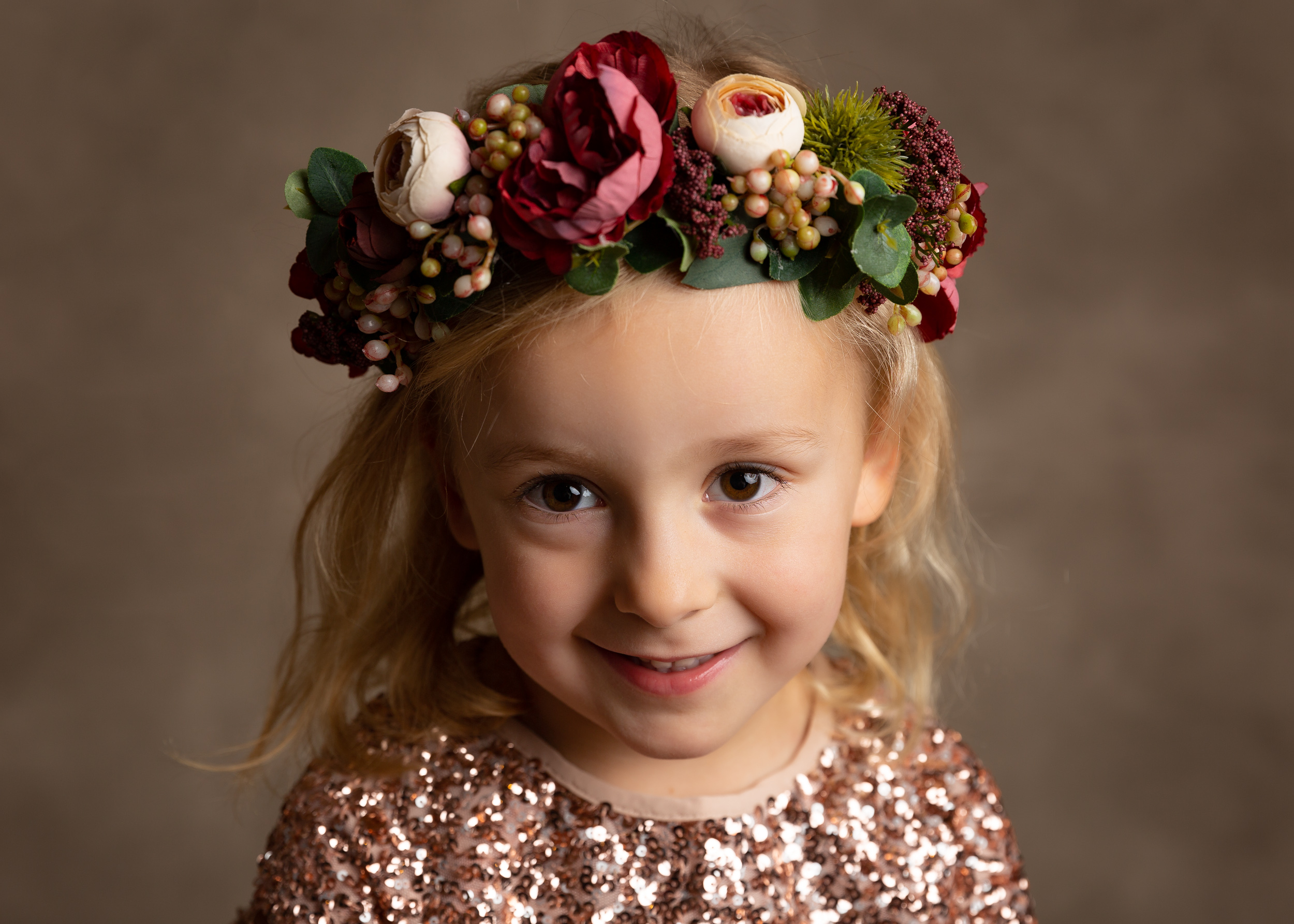 Little girl with a floral headress on during a family portrait session in Cheshire