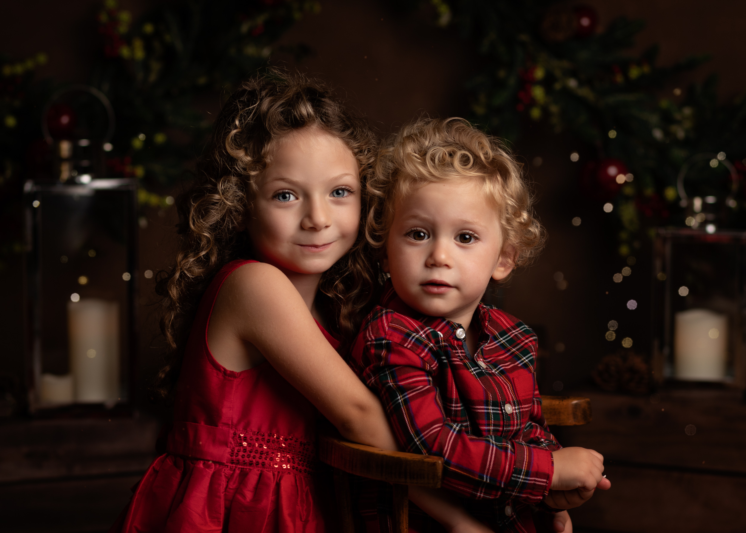 Brother and sister posing for their Christmas Mini Session photo shoot in Cheshire