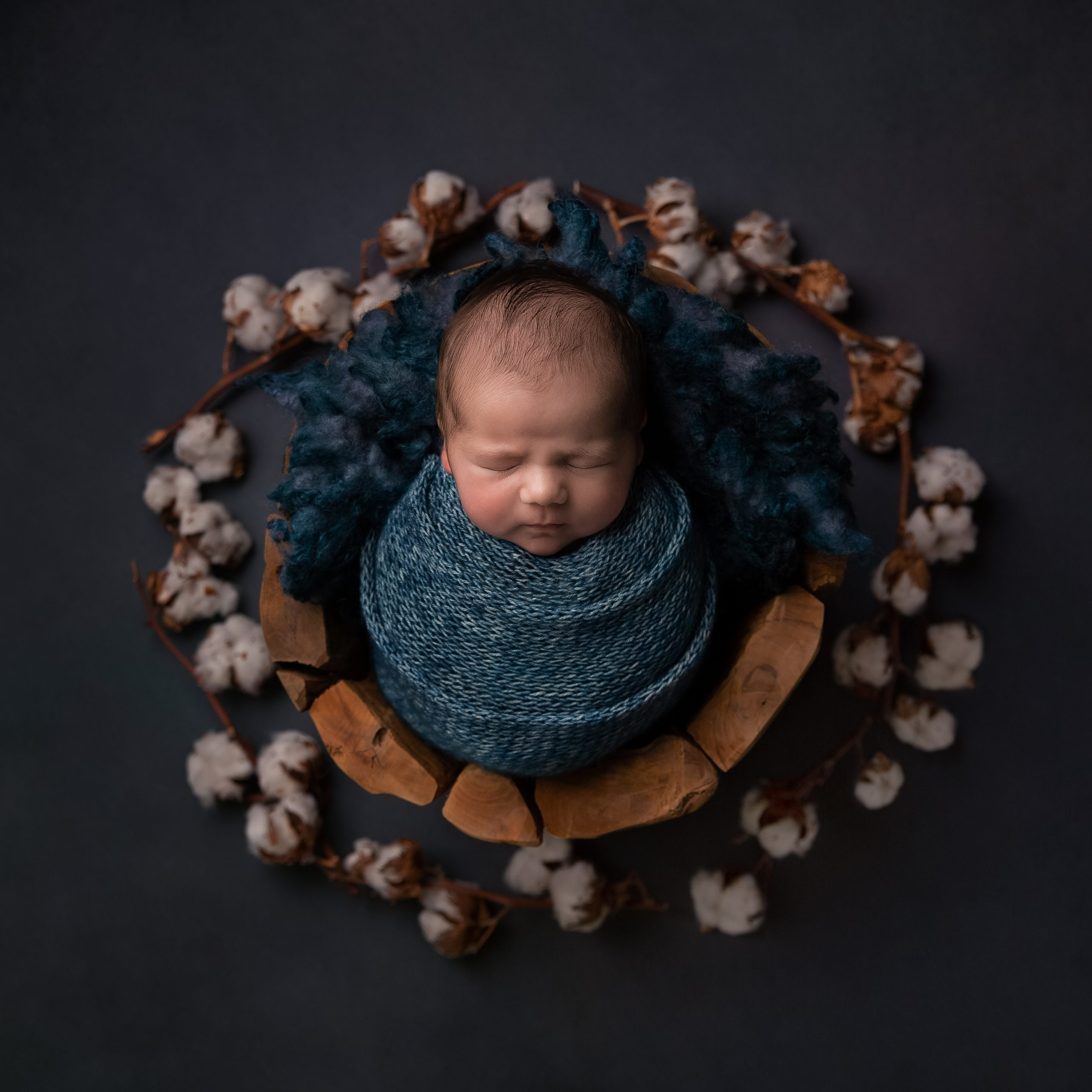 Newborn baby wrapped in blue as part of my Master Craftsman in Newborn Photography panel by award winning photographer