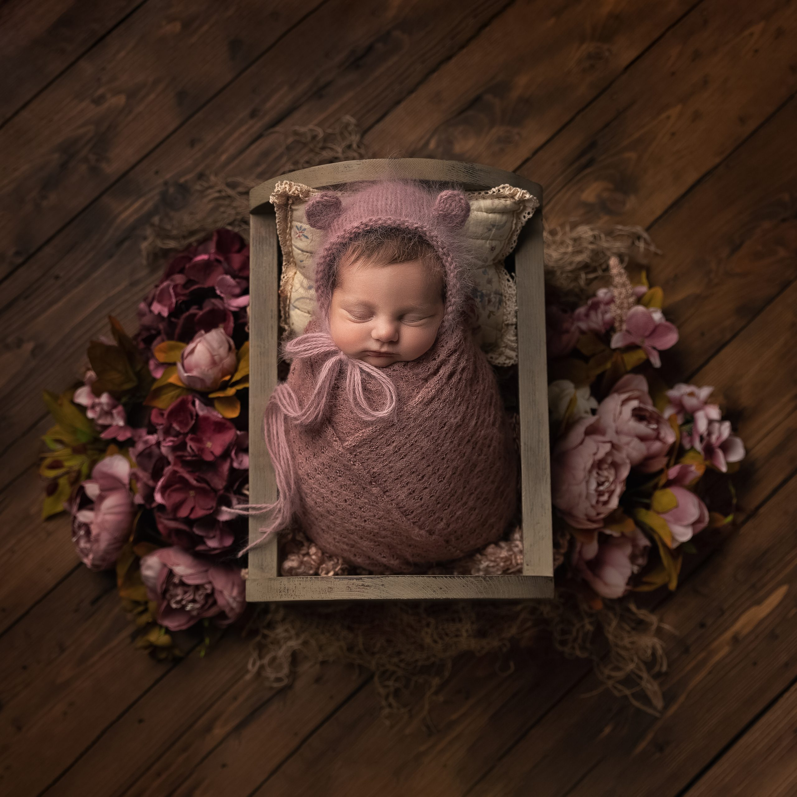 Pink floral newborn photo shoot as part of my Master Craftsman in Newborn Photography panel by award winning photographer