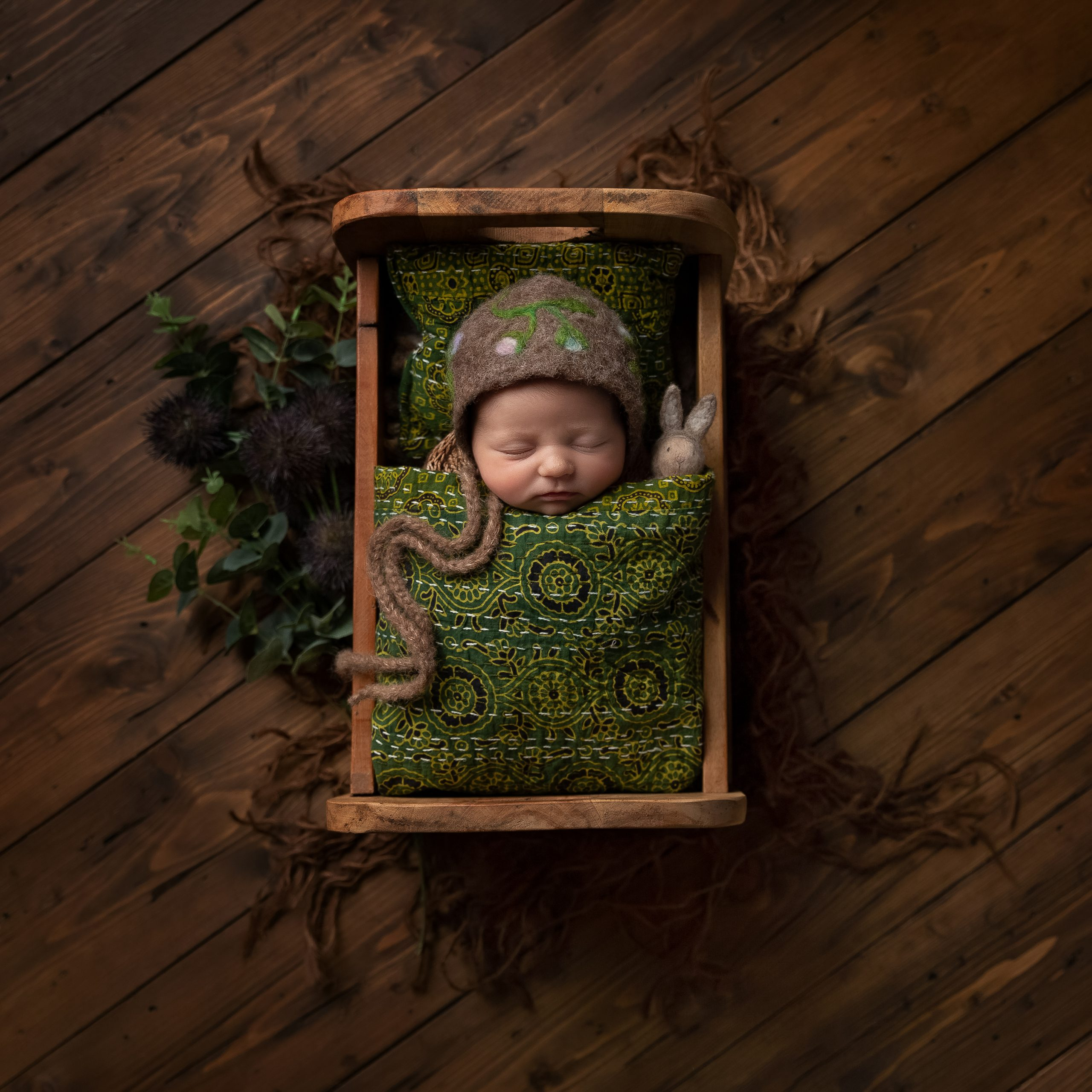Newborn in a little bed as part of my Master Craftsman in Newborn Photography panel by award winning photographer