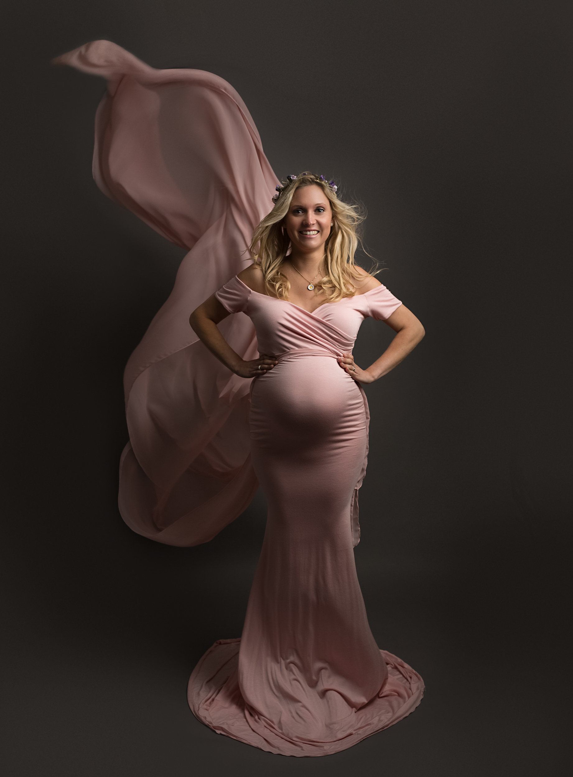 Pregnant lady in a floating pink dress at her maternity photo shoot in Sandbach, Cheshire