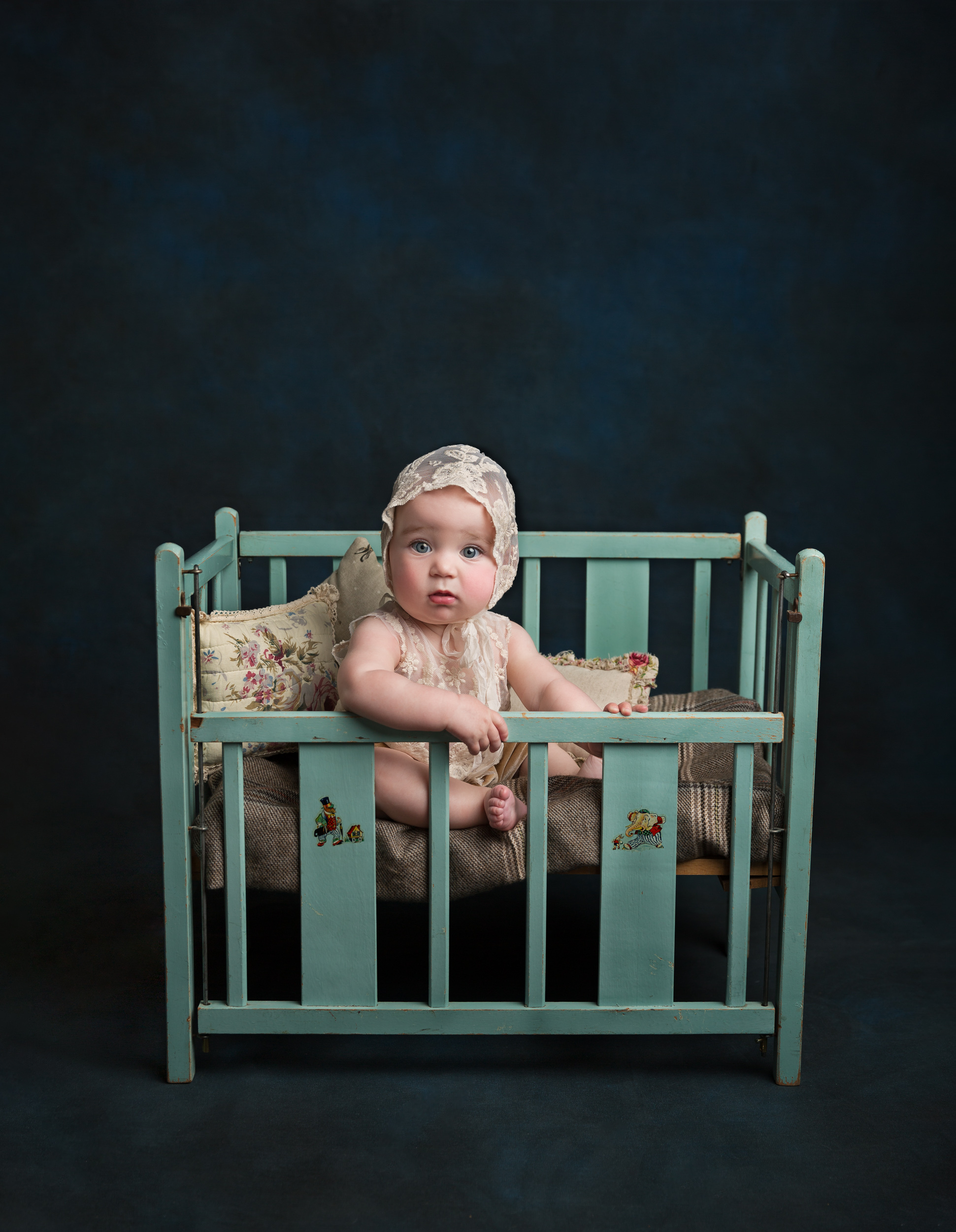 Fine art style portrait of a sitting baby girl during her sitter session in Sandbach, Cheshire
