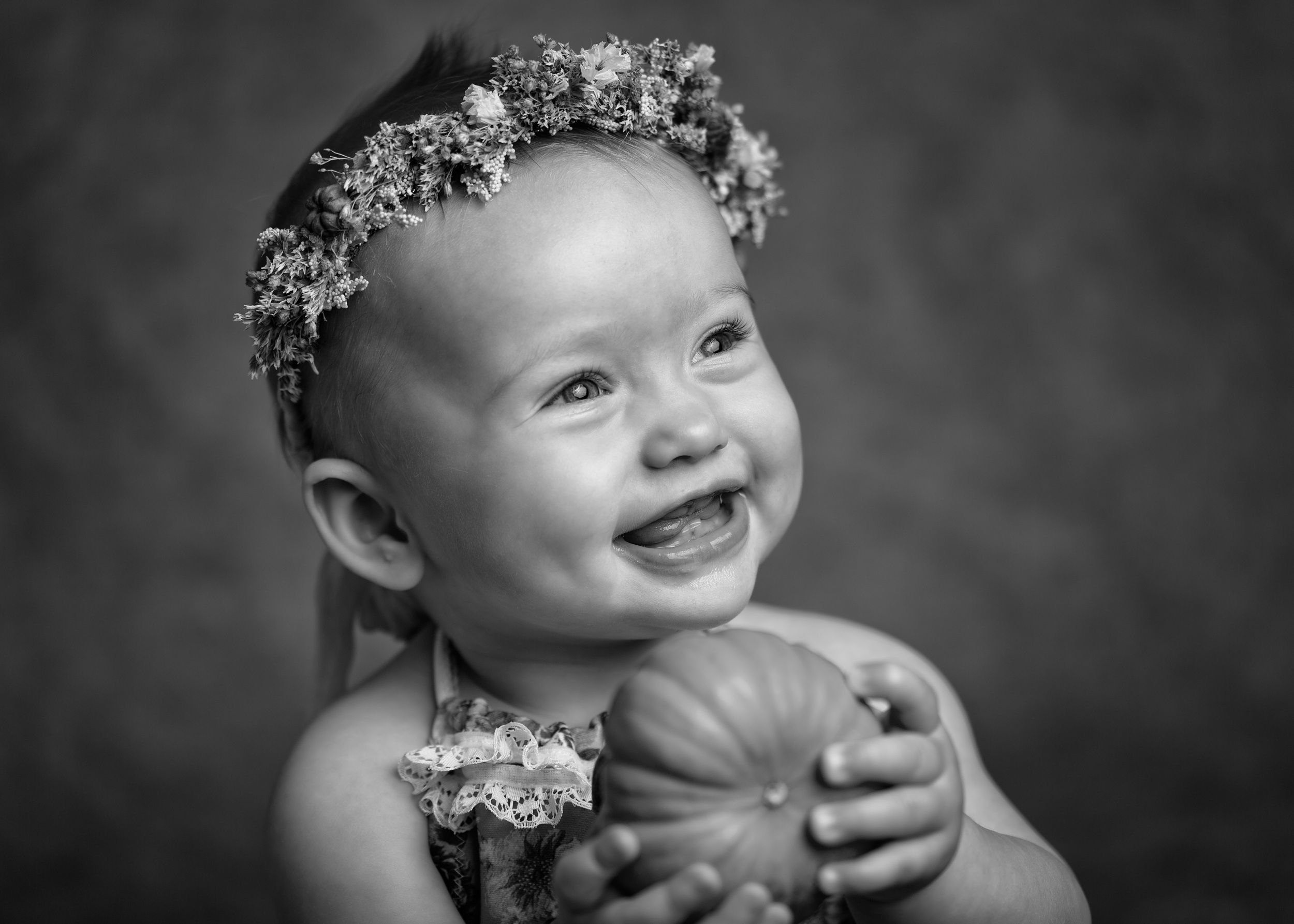 Beautiful smiling girl with a pumpkin taken during a milestone portrait session in Sandbach, Cheshire