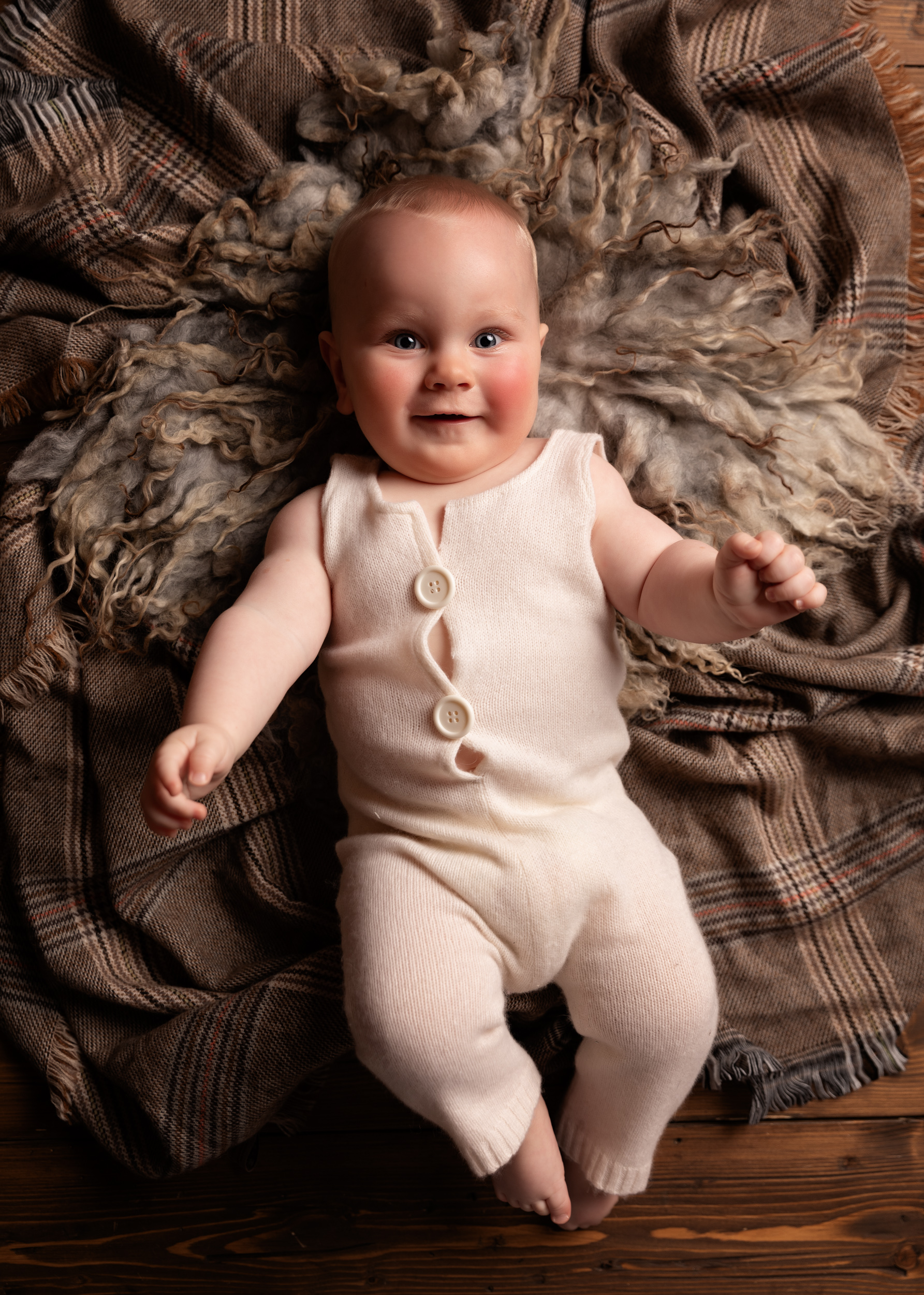 Full length image of 6 month old baby during a sitter session in Sandbach, Cheshire