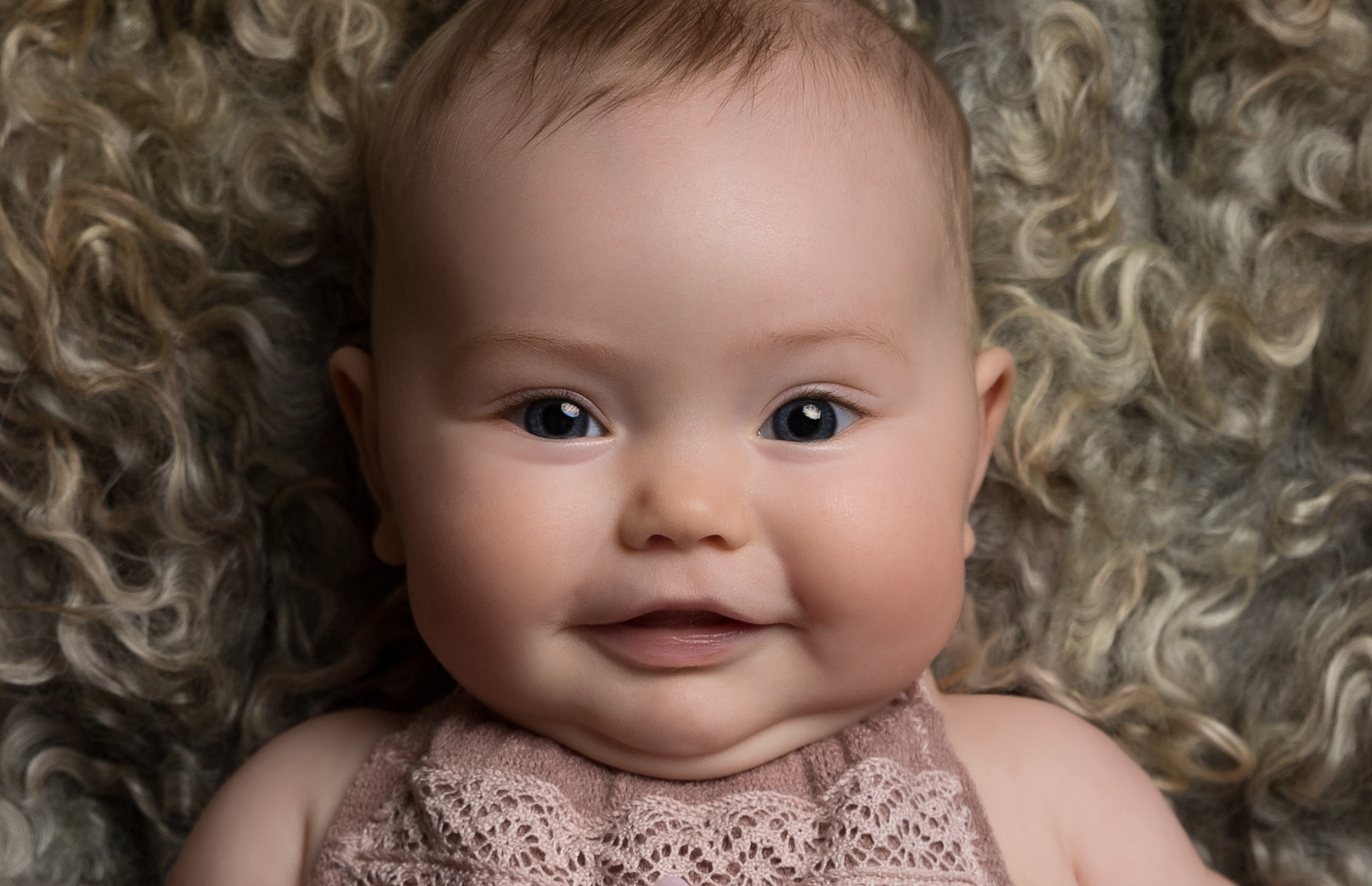 Cute close up of 6 month old baby girl in Sandbach, Cheshire