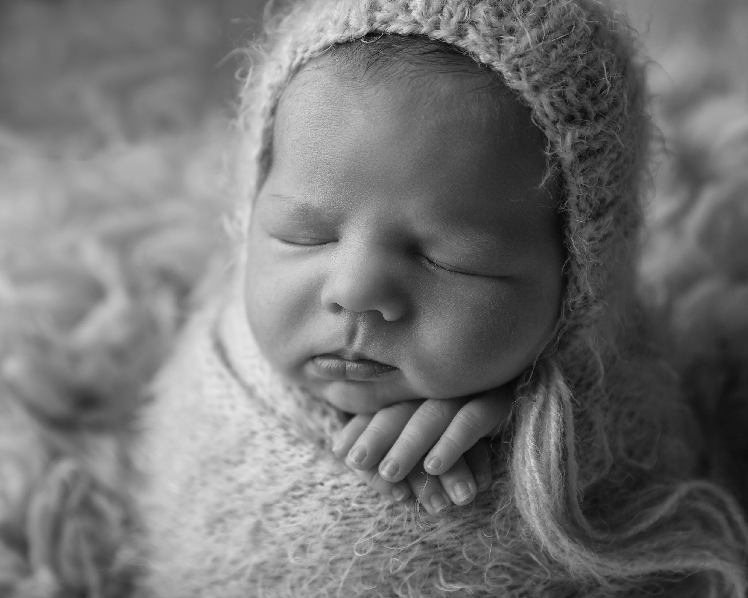 Close up of a newborn baby's face in potato sack pose by Cheshire newborn photographer in Sandbach