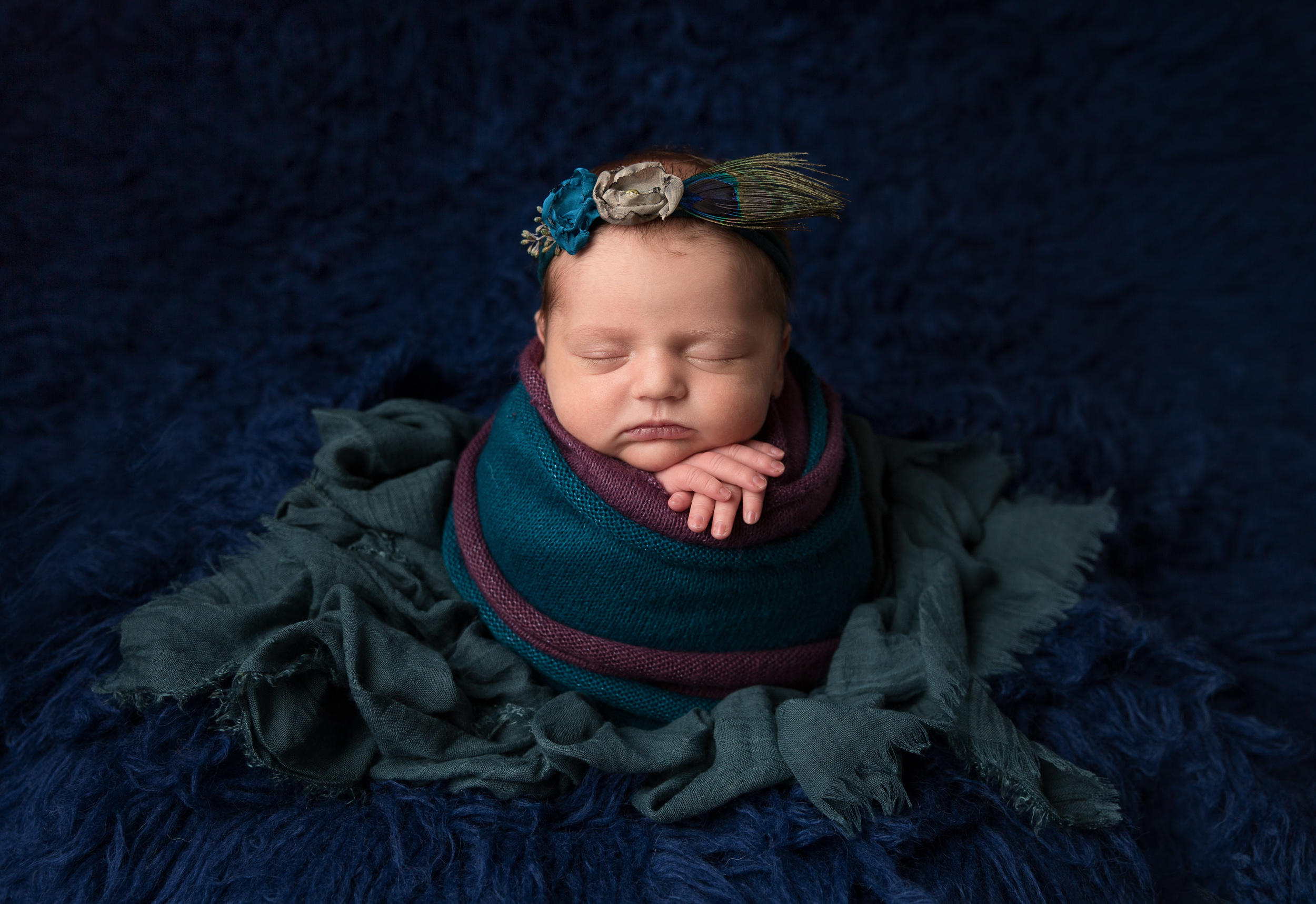 Peacock colour scheme for newborn baby girl in potato sack pose by Cheshire newborn photographer in Sandbach