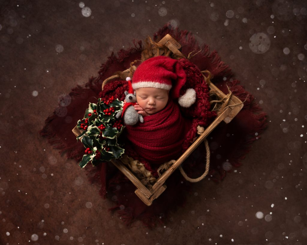Christmas themed newborn image by Cheshire newborn photographer in Sandbach