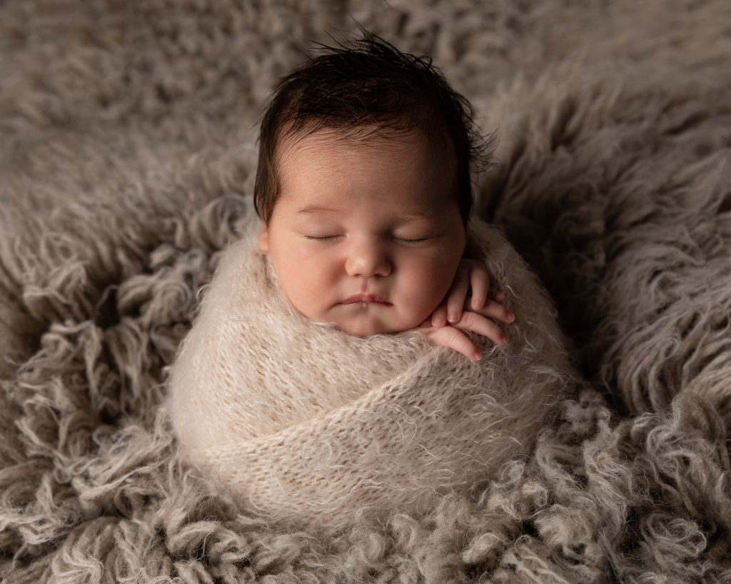 Baby girl in potato sack pose by Cheshire newborn photographer in Sandbach