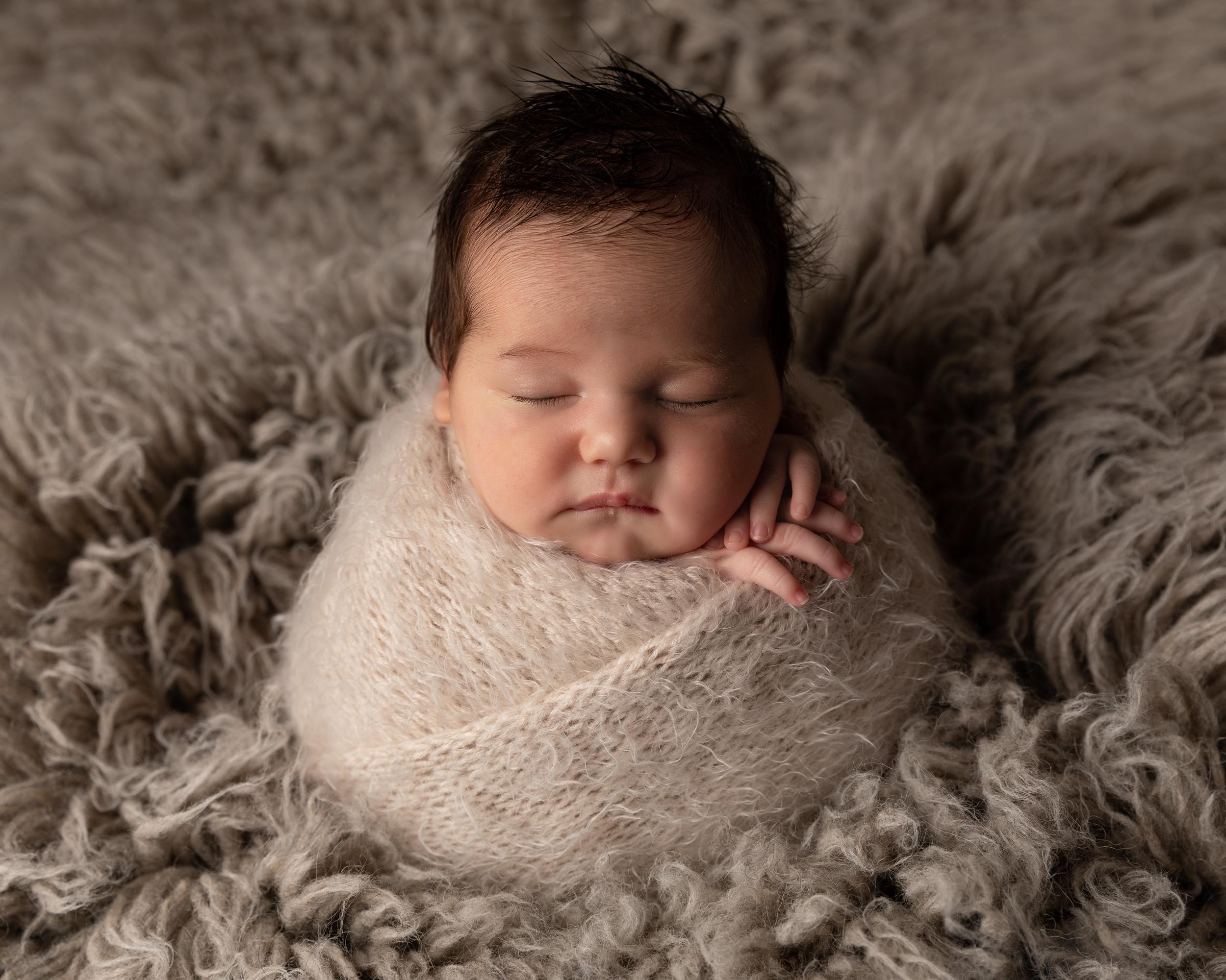 Baby girl in potato sack pose by Cheshire newborn photographer in Sandbach