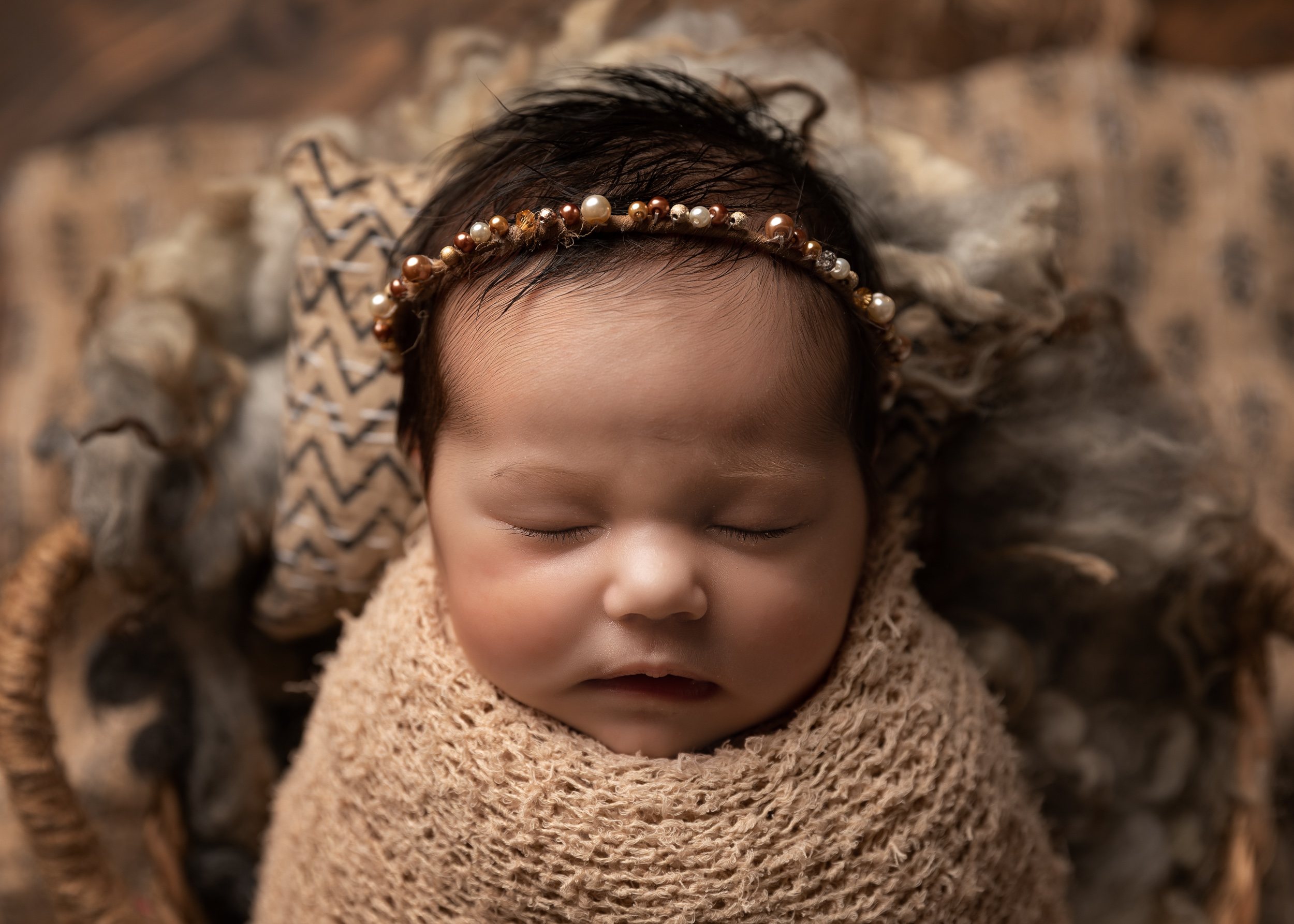 Taupe colour scheme newborn baby girl with jewelled headband by Cheshire newborn photographer in Sandbach