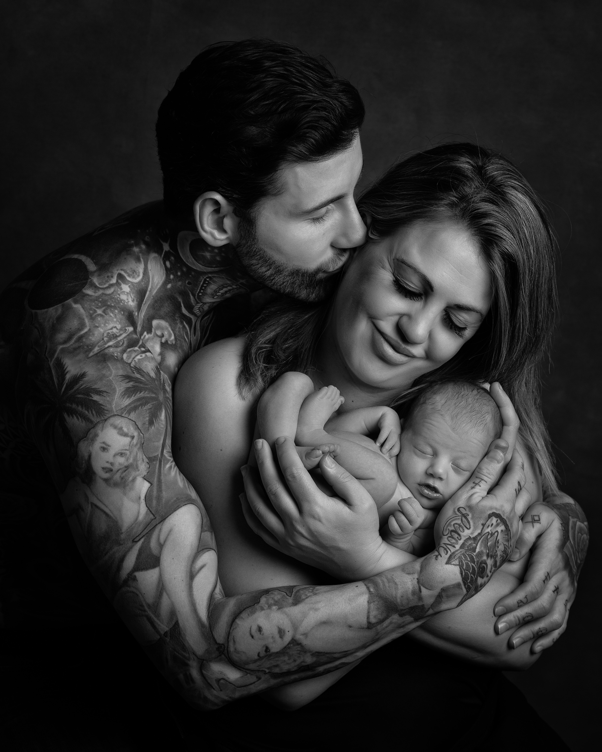 Jeremy McConnell and his newborn baby girl Storm in black and white by Cheshire newborn photographer in Sandbach