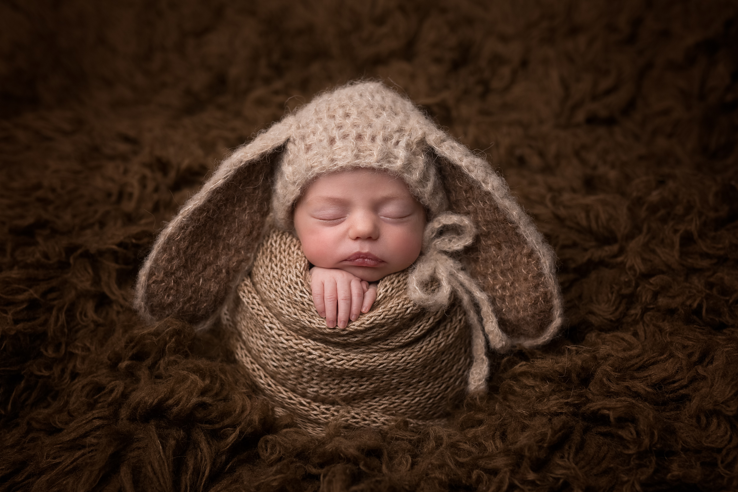 Award winning newborn photo of a baby with bunny wars on by Cheshire newborn photographer in Sandbach