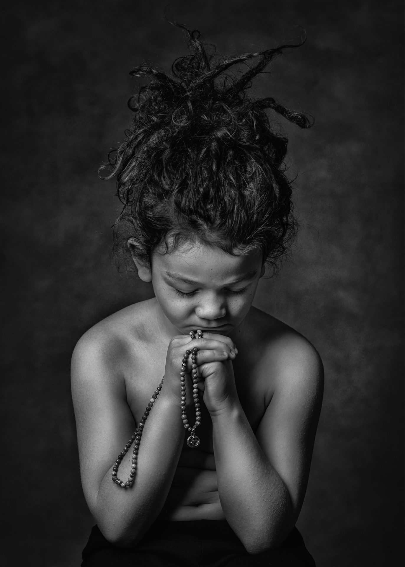 Award winning portrait of a 6 year old little boy praying in Cheshire